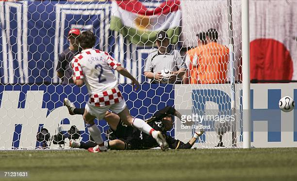 Goalkeeper Yoshikatsu Kawaguchi of Japan dives to save the penalty kick from Darijo Srna of Croatia during the FIFA World Cup Germany 2006 Group F...