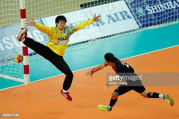 Goalkeeper Yuki Kubo of Japan in action with ChiaWei Weng of Chinese Taibei during the Handball Men's Group D match between Chinese Taipei and Japan...