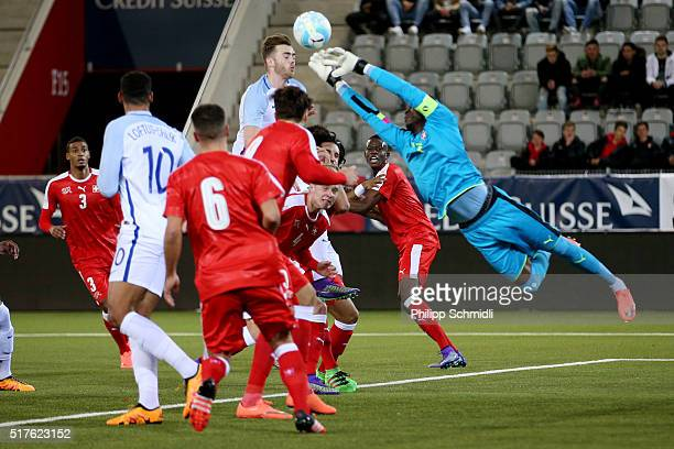 Goalkeeper Yvon Mvogo of Switzerland U21 saves the ball as Calum Chambers of England U21 goes for a header during the European Under 21 Qualifier...