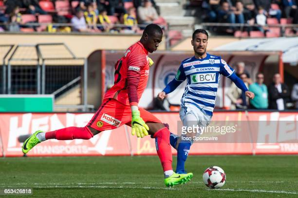 Goalkeeper Yvon Mvogo vies with Samuele Campo during the Swiss Super League match between FC LausanneSport and BSC Young Boys at Stade Olympique de...