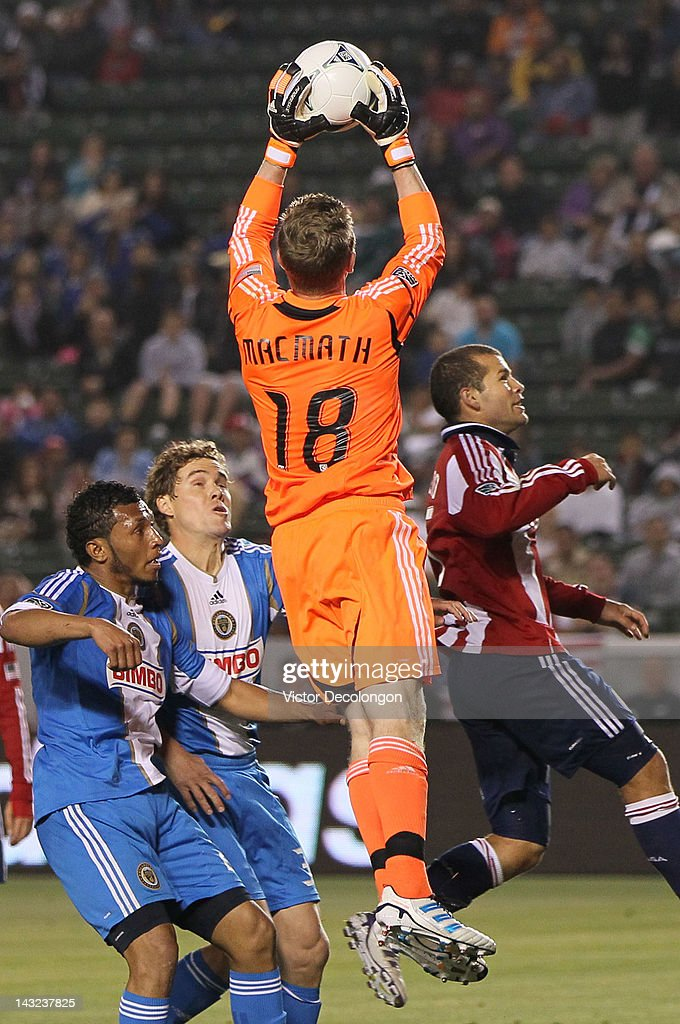 Goalkeeper Zac MacMath #18 of Philadelphia Union makes a save in front of <a gi-track='captionPersonalityLinkClicked' href=/galleries/search?phrase=Alejandro+Moreno&family=editorial&specificpeople=2245882 ng-click='$event.stopPropagation()'>Alejandro Moreno</a> #15 of Chivas USA (R) as teammates <a gi-track='captionPersonalityLinkClicked' href=/galleries/search?phrase=Chris+Albright&family=editorial&specificpeople=178253 ng-click='$event.stopPropagation()'>Chris Albright</a> #3 and Carlos Valdes #2 look on in the second half of their MLS match at The Home Depot Center on April 21, 2012 in Carson, California. The Union defeated Chivas USA 1-0.