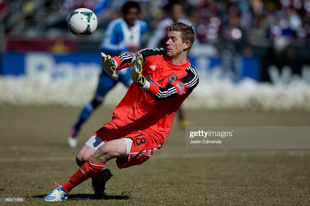 Goalkeeper Zac MacMath #18 of the Philadelphia Union makes a save against the Colorado Rapids at Dick's Sporting Goods Park on March 10, 2013 in Commerce City, Colorado. The Union defeated the Rapids 2-1.