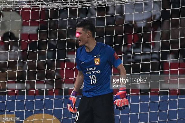 Goalkeeper Zeng Cheng of Guangzhou Evergrande appears to be targeted by a laser pointer during the first leg of the AFC Champions League final match...