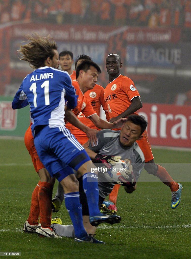 Goalkeeper Zhang Lie #12 of Guizhou Renhe saves the ball during the AFC Asian Champions League match between Guizhou Renhe and Ulsan Hyundai at Guiyang Olympic Centre on April 1, 2014 in Guiyang, China.