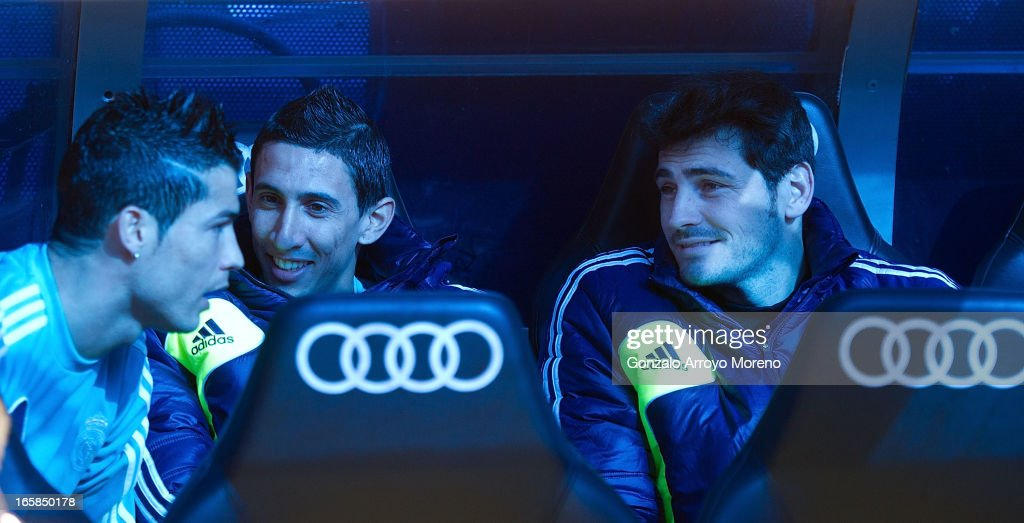 Goalkeeperalkeeper Iker Casillas (R) of of Real Madrid CF Madrid on the bench with teammates Angel Di Maria (2ndR) and Cristiano Ronaldo (L) prior to tries to start the La Liga match between Real Madrid CF and Levante UD at Santiago Bernabeu Stadium on April 6, 2013 in Madrid, Spain.