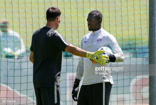 Goalkeepercoach Frederik Goessling of RB Leipzig speak with Goalkeeper Yvon Mvogo of RB Leipzig during the Training Camp of RB Leipzig on July 21...