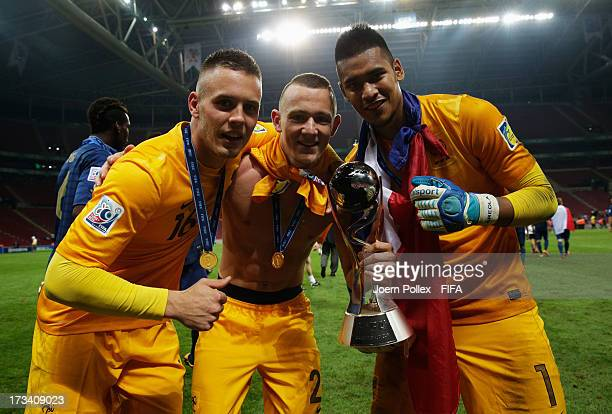 Goalkeepers Alphonse Areola Maxime Dupe and Paul Charruau celebrate with the cup after winning the FIFA U20 World Cup Final match between France and...