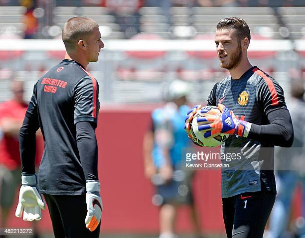 Goalkeepers David De Gea of Manchester United holding the soccer ball talks with Sam Johnstone during warm up before the start of International...