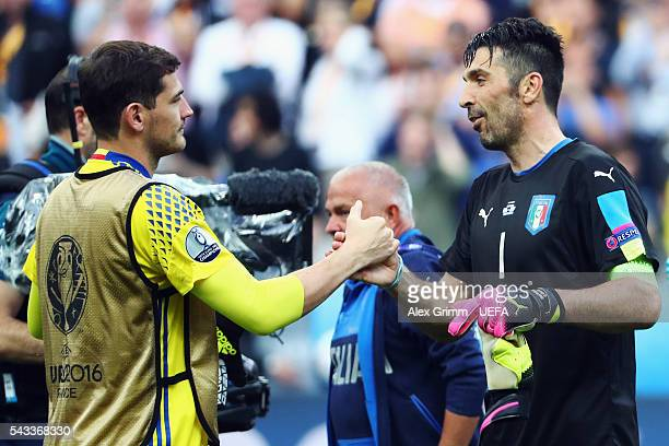 Goalkeepers Gianluigi Buffon of Italy and Iker Casillas of Spain shake hands after the UEFA EURO 2016 round of 16 match between Italy and Spain at...