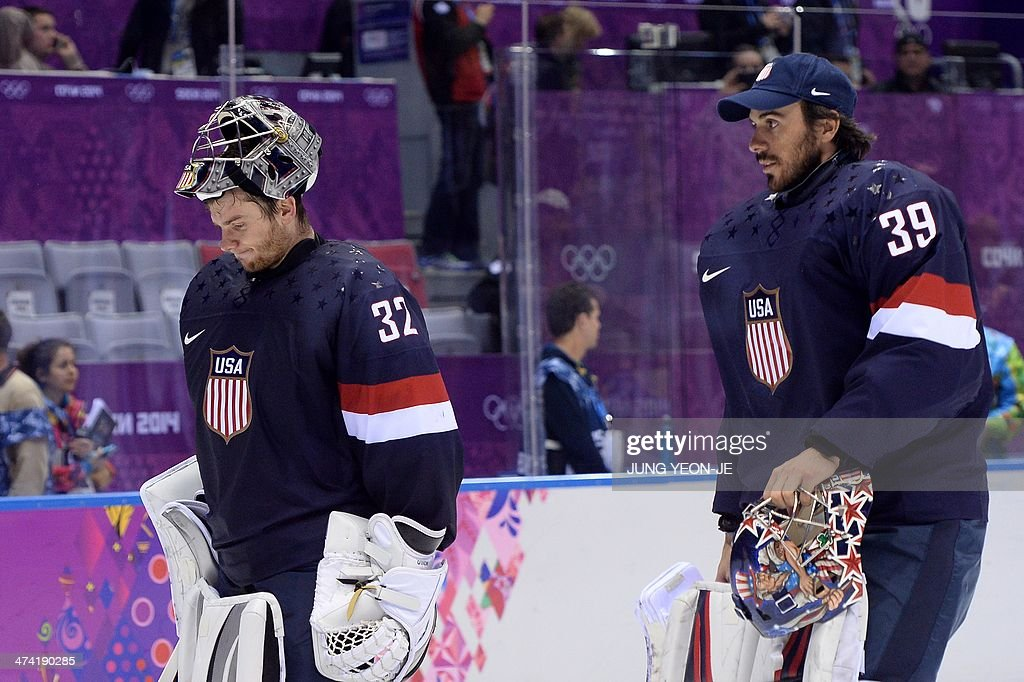 US goalkeepers Jonathan Quick (L) and Ryan Miller leave after losing the Men's ice hockey Bronze Medal Game USA vs Finland at the Bolshoy Ice Dome during the Sochi Winter Olympics on February 22, 2014.