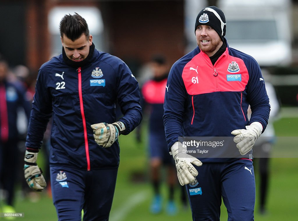 Goalkeepers Karl Darlow (L) and Rob Elliot (R) walk out on the pitch during the Newcastle United Training session at The Newcastle United Training Centre on December 22, 2015, in Newcastle upon Tyne, England.