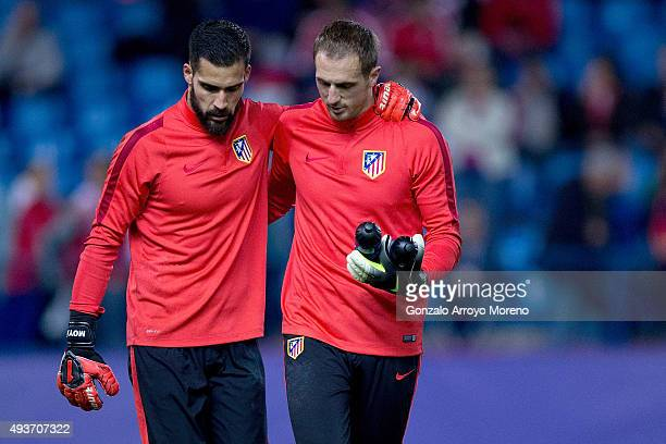 Goalkeepers Miguel Angel Moya and Jan Oblak of Atletico de Madrid embrace together after their warming up before the UEFA Champions League Group C...