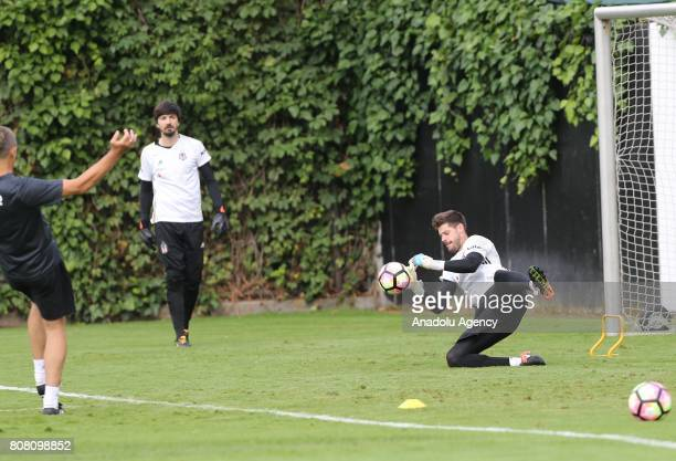 Goalkeepers of Besiktas Tolga Zengin and Fabricio Agosto Ramirez attend the team's training session within the preparations for next soccer season at...