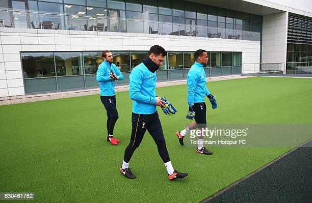 Goalkeepers Pau Lopez Hugo Lloris and Michel Vorm walk to the pitch during a Tottenham Hotspur training session at Tottenham Hotspur Training Centre...