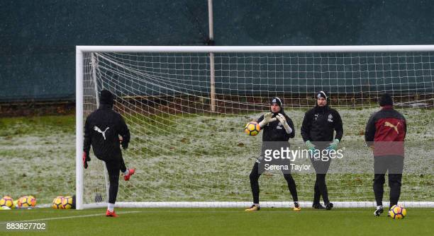 Goalkeepers Paul Woolston Karl Darlow and Rob Elliot warm up with Newcastle United's Goalkeeping Coach Simon Smith during the Newcastle United...