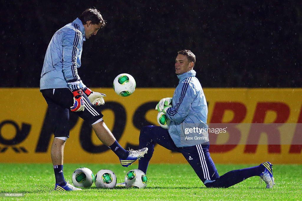 Goalkeepers Rene Adler (L) and Manuel Neuer attend a Germany training session at Commerzbank-Arena on February 4, 2013 in Frankfurt am Main, Germany.