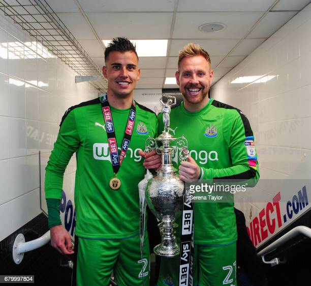 Goalkeepers Rob Elliot and Karl Darlow pose for a photo with the championship trophy after Newcastle win the championship during the Sky Bet...