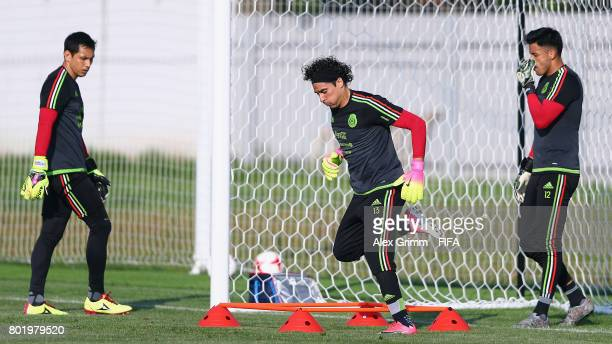Goalkeepers Rodolfo Cota Guillermo Ochoa and Alfredo Talavera exercise during a Mexico training session at Adler training ground ahead of their FIFA...
