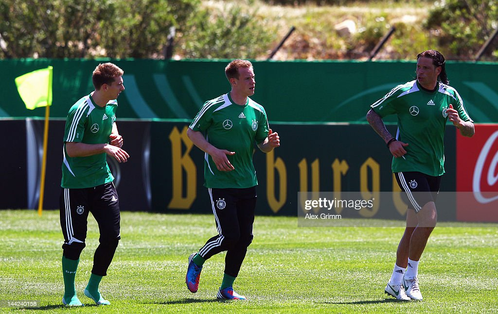 Goalkeepers RonRobert Zieler MarcAndre ter Stegen and Tim Wiese run during a Germany training session at Campo Sportivo Comunale Andrea Dora on May...