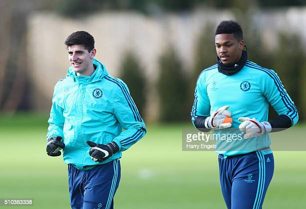 Goalkeepers Thibaut Courtois and Jamal Blackman of Chelsea warm up during a Chelsea training session ahead of their UEFA Champions League round of 16...