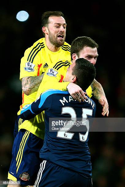 GoalkeeperVito Mannone of Sunderland is congratulated by teammates Craig Gardner and Steven Fletcher after saving the penalty from Rafael Da Silva of...