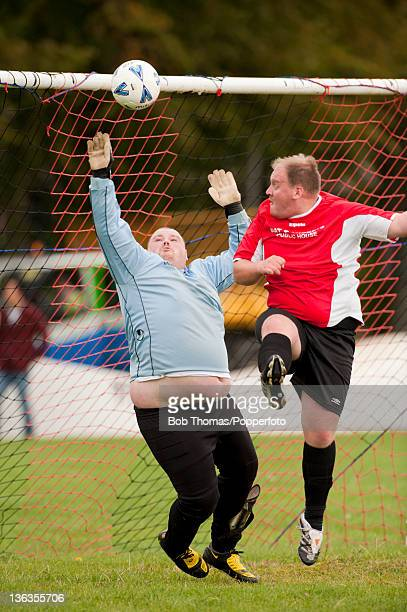 Goalkeeping action during a Sunday League football match on the Racecourse in Northampton England 5th September 2009