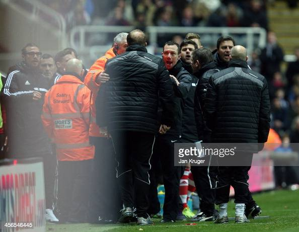 Goalkeeping Coach of Newcastle United Andy Woodwin is reprimanded by Fourth official Kevin Friend after a tussle with Manager of Southampton Mauricio...