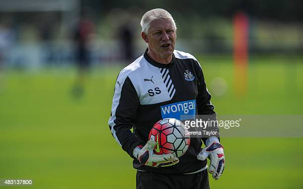 Goalkeeping Coach Simon Smith holds a ball during a Newcastle United Training session at The Newcastle United Training Centre on August 6 in...