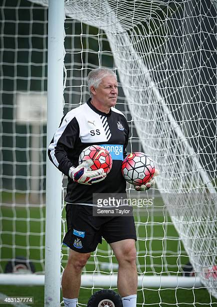Goalkeeping coach Simon Smith holds a ball in each hand during a Newcastle United Training session at The Newcastle United Training Centre on August...