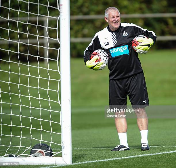 Goalkeeping coach Simon Smith holds a ball under each arm during the Newcastle United Training session at The Newcastle United Training Centre on...