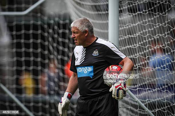Goalkeeping Coach Simon Smith holds a ball under his arm during the Newcastle United Open Training session at StJames' Park on August 4 in Newcastle...