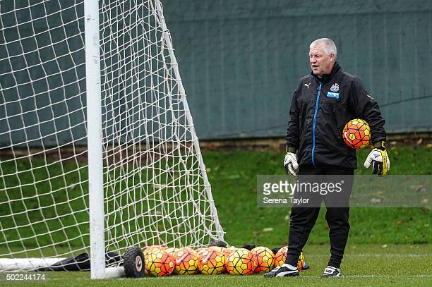 Goalkeeping Coach Simon Smith looks on with a ball under arm during the Newcastle United Training session at The Newcastle United Training Centre on...
