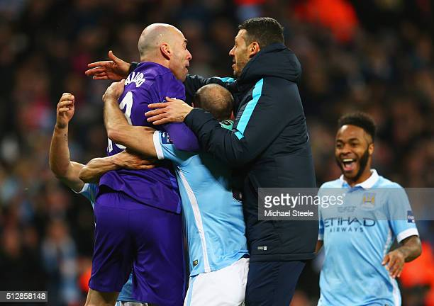 Goalkeeping hero Willy Caballero of Manchester City ismobbed by team mates in celebration after the Capital One Cup Final match between Liverpool and...