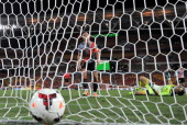 Goalkeepr Michael Theo is on the ground as team mate Matthew Smith watches the ball hit the back of the net after Joseph Gibbs of the Jets gets the...