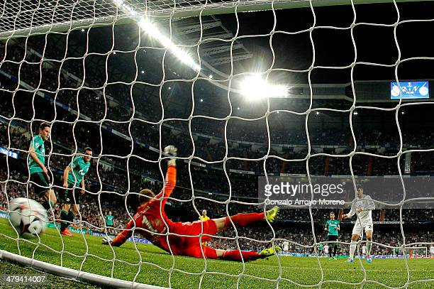 Goalkeepr Ralf Fahrmann of Schalke dives in vain as Alvaro Morata of Real Madrid scores his team's third goal during the UEFA Champions League Round...