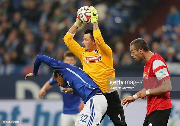 Goalkeepr Roman Buerki of Freiburg grabs the ball near Joel Matip of Schalke and Pavel Krmas during the Bundesliga match between Schalke 04 and SC...