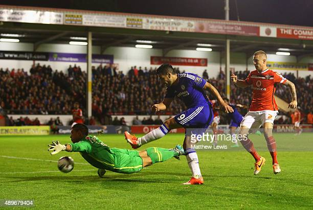 Goalkepper Neil Etheridge of Walsall attempts to block Radamel Falcao Garcia of Chelsea during the Capital One Cup third round match between Walsall...