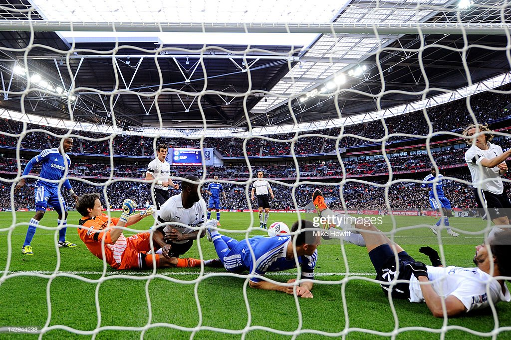 Goalmouth scramble involving <a gi-track='captionPersonalityLinkClicked' href=/galleries/search?phrase=Carlo+Cudicini&family=editorial&specificpeople=226724 ng-click='$event.stopPropagation()'>Carlo Cudicini</a> of Tottenham Hotspur, <a gi-track='captionPersonalityLinkClicked' href=/galleries/search?phrase=Ledley+King&family=editorial&specificpeople=206640 ng-click='$event.stopPropagation()'>Ledley King</a> of Tottenham Hotspur, <a gi-track='captionPersonalityLinkClicked' href=/galleries/search?phrase=John+Terry&family=editorial&specificpeople=171535 ng-click='$event.stopPropagation()'>John Terry</a> of Chelsea and <a gi-track='captionPersonalityLinkClicked' href=/galleries/search?phrase=Benoit+Assou-Ekotto&family=editorial&specificpeople=709848 ng-click='$event.stopPropagation()'>Benoit Assou-Ekotto</a> of Tottenham Hotspur as Juan Mata of Chelsea (not pictured) scores their second goal during the FA Cup with Budweiser Semi Final match between Tottenham Hotspur and Chelsea at Wembley Stadium on April 15, 2012 in London, England.