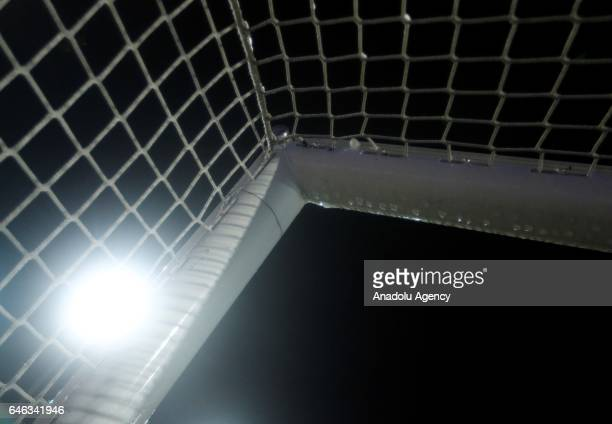 A goalpost with raindrops is seen during heavy rain fall in Lotte Germany on February 28 2017 Sportfreunde Lotte and Borussia Dortmund were supposed...
