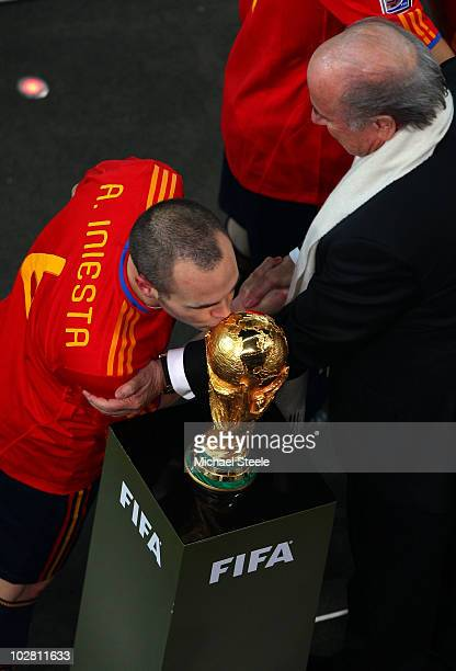 Goalscorer Andres Iniesta of Spain kisses the World Cup as he collects his medal during the 2010 FIFA World Cup South Africa Final match between...
