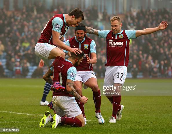 Goalscorer Ashley Barnes of Burnley jumps on Danny Ings of Burnley as he celebrates scoring the opening goal during the Barclays Premier League match...