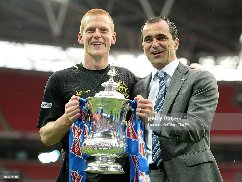 Goalscorer Ben Watson and Wigan Athletic manager Roberto Martinez celebrate with the trophy after victory in the FA Cup with Budweiser Final match between Manchester City and Wigan Athletic at Wembley Stadium on May 11, 2013 in London, England.