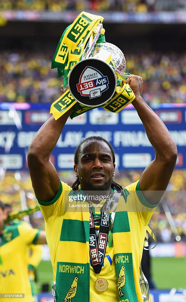Goalscorer Cameron Jerome of Norwich City celebrates with the trophy after the Sky Bet Championship Playoff Final between Middlesbrough and Norwich City at Wembley Stadium on May 25, 2015 in London, England. Norwich City seal promotion to the Premier League with a 2-0 victory