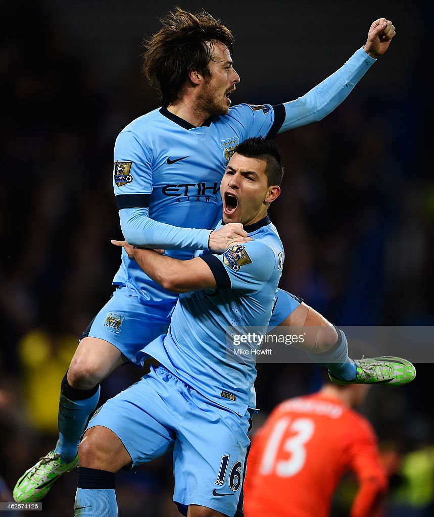 Goalscorer <a gi-track='captionPersonalityLinkClicked' href=/galleries/search?phrase=David+Silva&family=editorial&specificpeople=675795 ng-click='$event.stopPropagation()'>David Silva</a> of Manchester City (L) celebrates with teammate <a gi-track='captionPersonalityLinkClicked' href=/galleries/search?phrase=Sergio+Aguero&family=editorial&specificpeople=1100704 ng-click='$event.stopPropagation()'>Sergio Aguero</a> after scoring the equalising goal during the Barclays Premier League match between Chelsea and Manchester City at Stamford Bridge on January 31, 2015 in London, England.