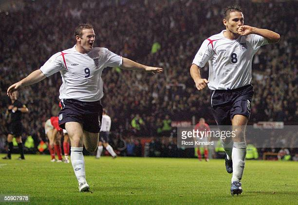 Goalscorer Frank Lampard of England celebrates with Wayne Rooney during the FIFA World Cup Group 6 qualifying match between England and Poland at Old...