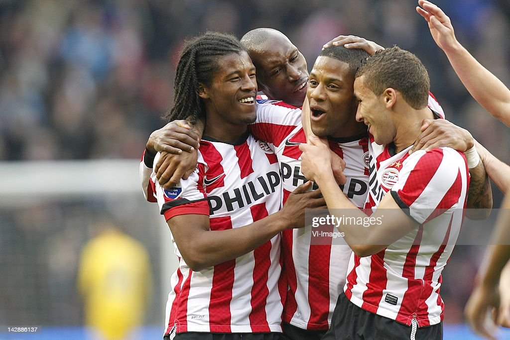 Goalscorer Jeremain Lens of PSV celebrates with Georginio Wijnaldum Zakaria Labyad and teammates during the Dutch Eredivisie match between PSV...