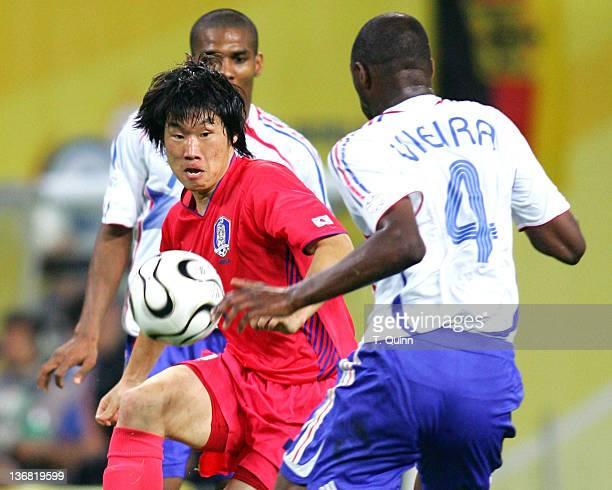 Goalscorer Ji Sung Park of Korea Republic battles Patrick Vieira of France for the ball during the Group G match at the Centralstadium in Leipzig...