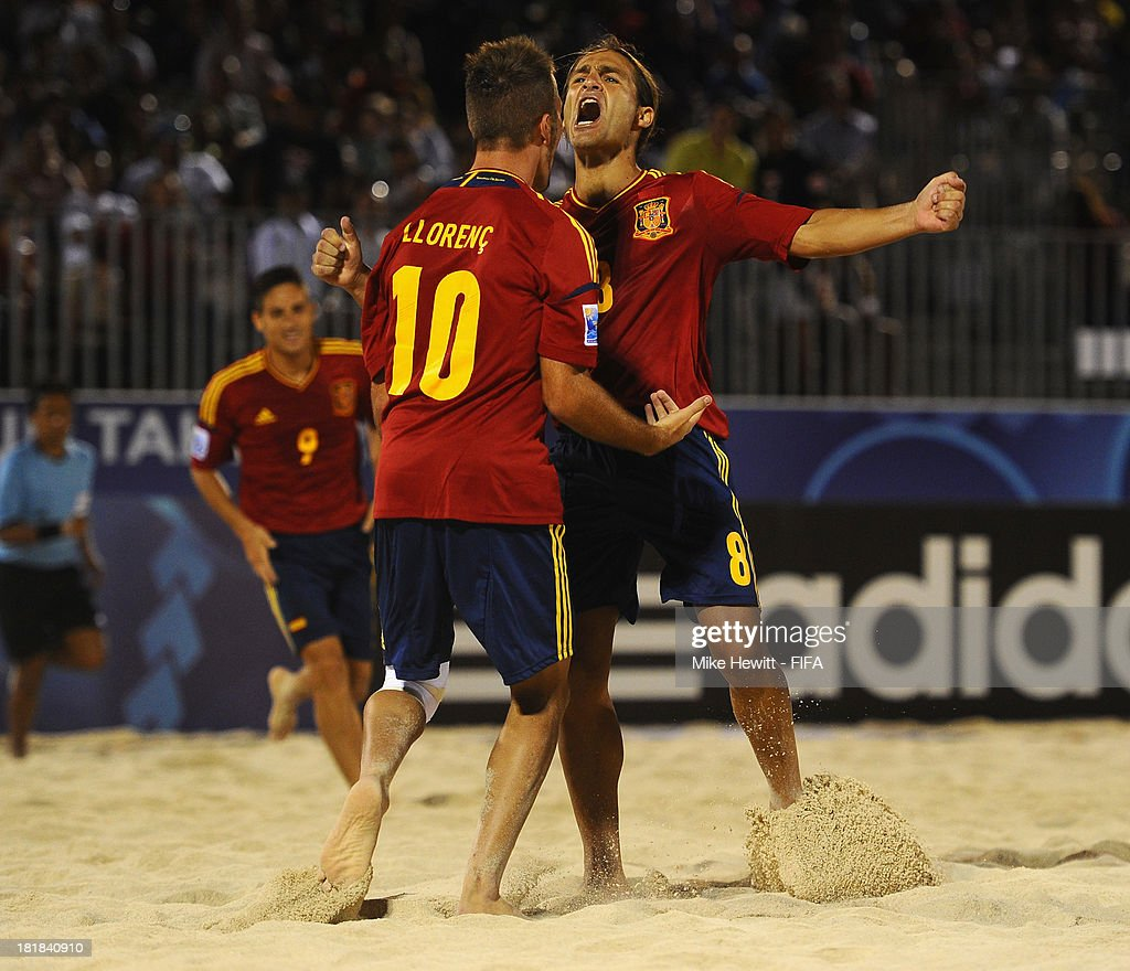 Goalscorer Llorenc of Spain celebrates with team mate Pajon after scoring during the FIFA Beach Soccer World Cup Tahiti 2013 Quarter Final match between Spain and El Salvador on at the Tahua To'ata Stadium on September 25, 2013 in Papeete, French Polynesia.