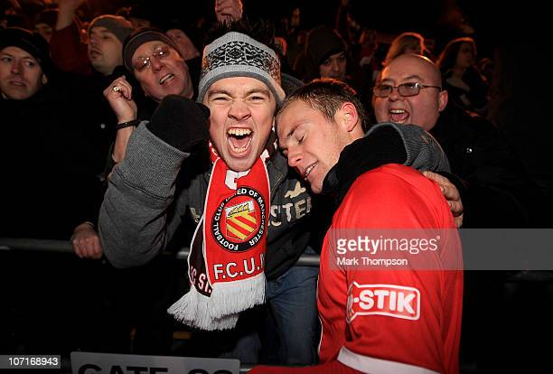 Goalscorer Nicky Platt of FC United Of Manchester celebrates his teams draw with fans during the FA Cup sponsored by EON at the Withdean stadium on...