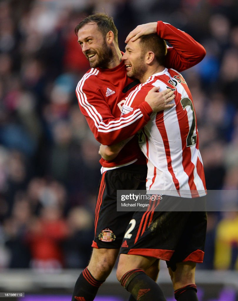 Goalscorer <a gi-track='captionPersonalityLinkClicked' href=/galleries/search?phrase=Phillip+Bardsley&family=editorial&specificpeople=878493 ng-click='$event.stopPropagation()'>Phillip Bardsley</a> of Sunderland celebrates at the final whistle with team mate Steven Fletcher after the Barclays Premier League match between Sunderland and Manchester City at the Stadium of Light on November 10, 2013 in Sunderland, England.